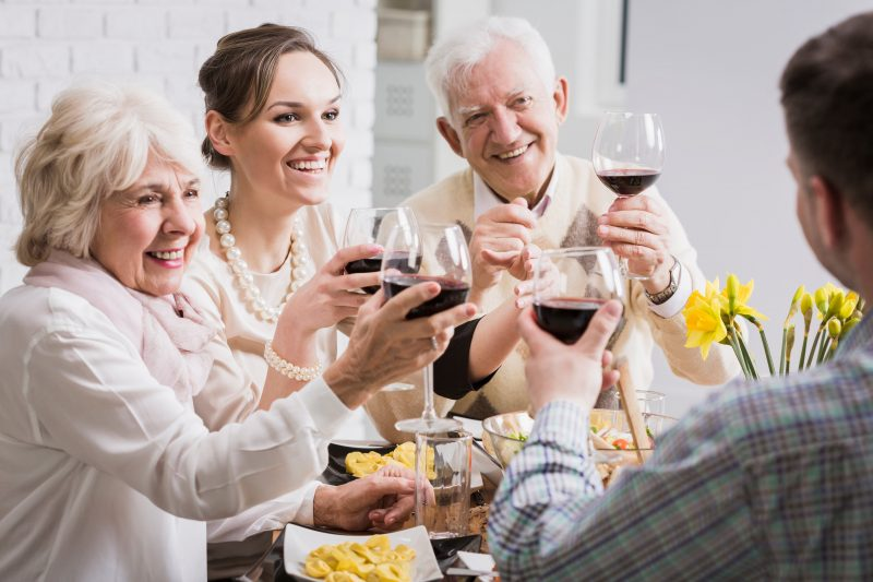 Family toasting red wine