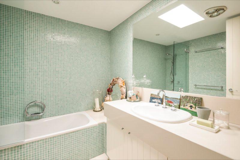 Enjoy beautifully designed mosaic tile featured bathrooms