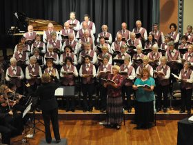 The full choir with orchestra