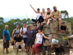 Team getting a group photo over looking Megalong Valley