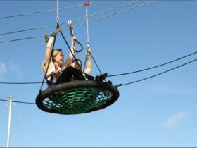 Flying through the air on the Skypeak Adventures aerial adventure course