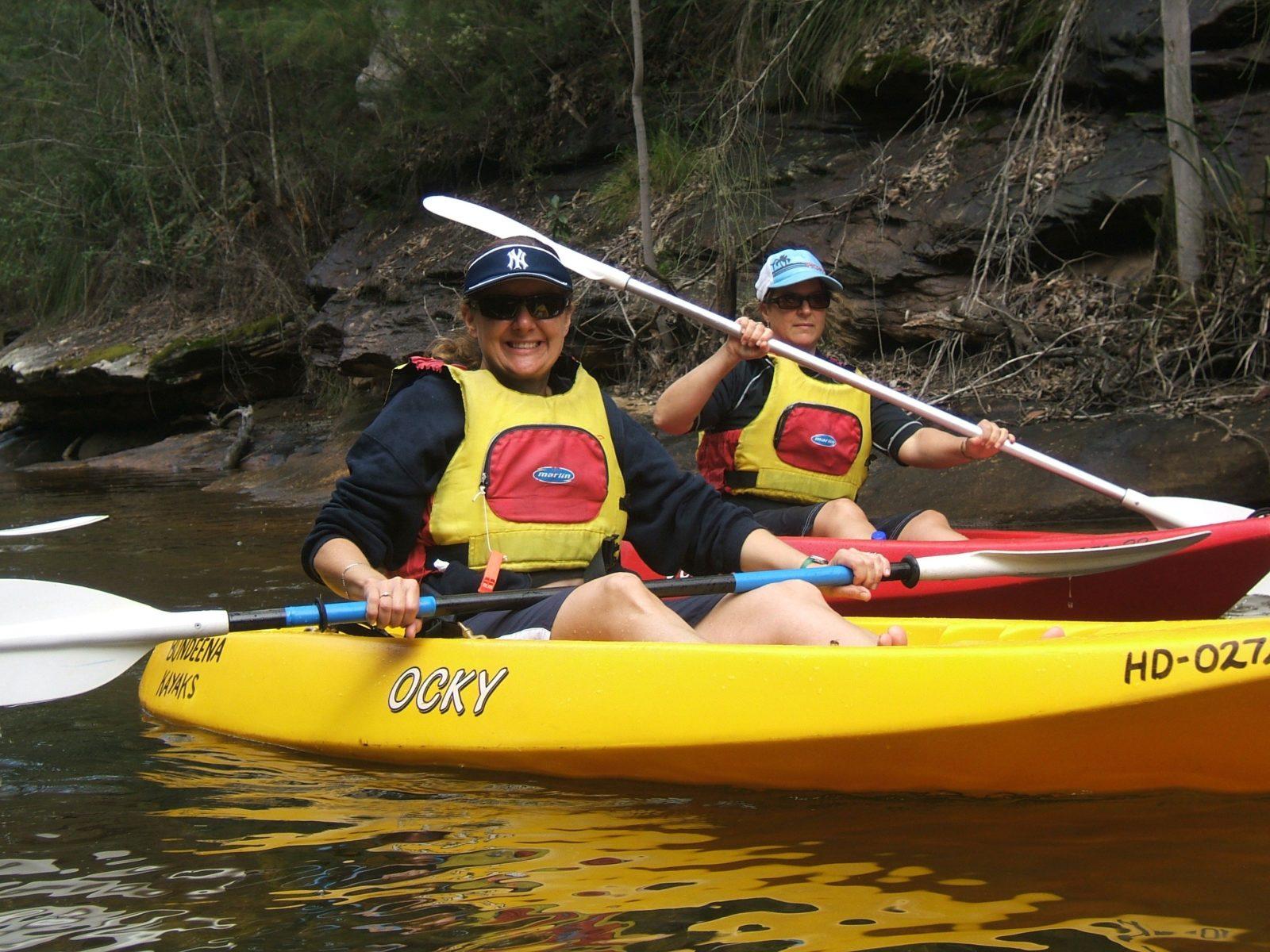 People in kayaking paddling at Bundeena