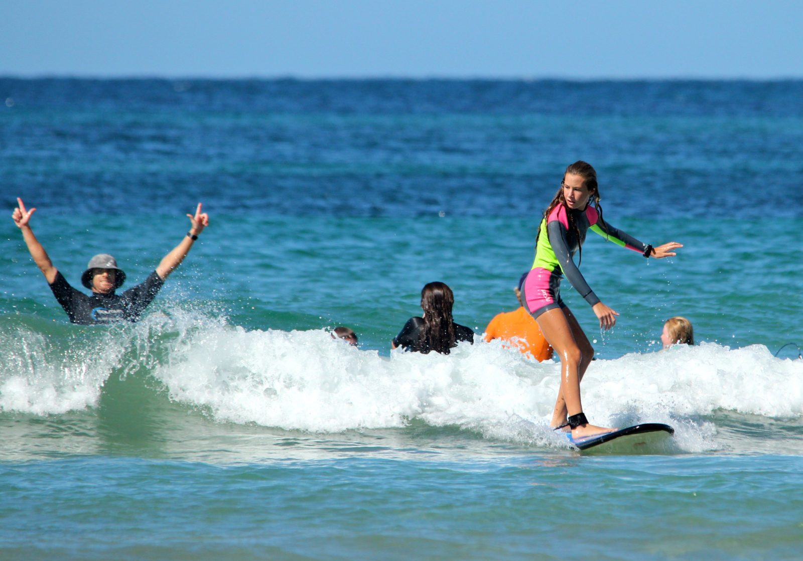 Coaches get as stoked as the participants with riding waves on the Coffs Coast