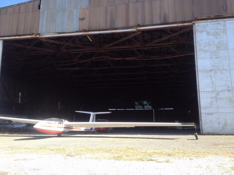 Club's two seater training glider at the entrance to the old WW2 hangar.