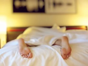 Feet of sleeping person out bottom of bed