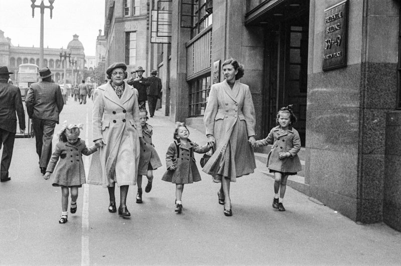 Photograph of a family walking down the street from the 1950s