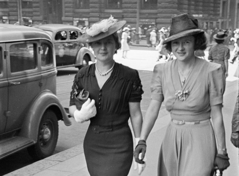 Photograph of two ladies walking down the street in the 1940s.