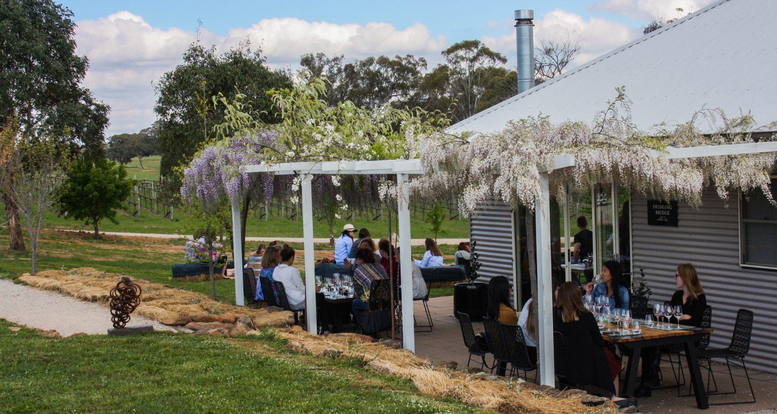 Customers enjoying the Swinging Bridge Wines