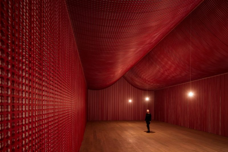 A large room of red paper created by Cornelia Parker