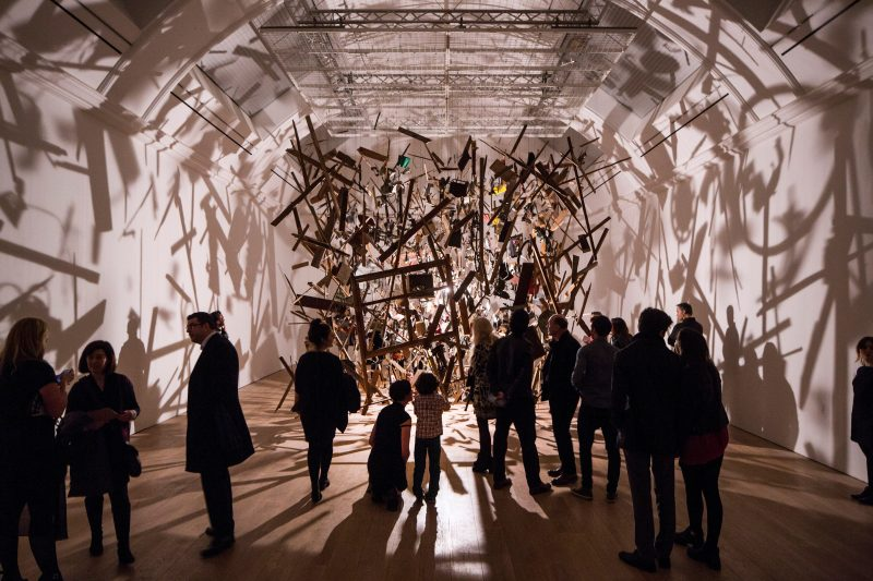 Cornelia Parker's artwork, Cold Dark Matter, an exploded garden shed hung from the ceiling in pieces