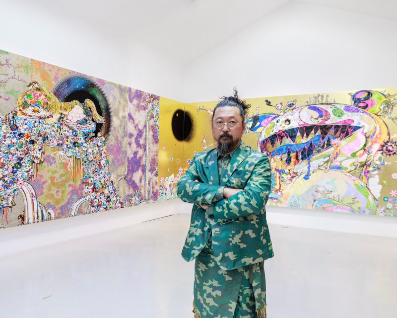 Artist Takashi Murakami in front of his work.