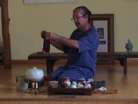 Tea Master Stephen Carroll performing a tea ceremony