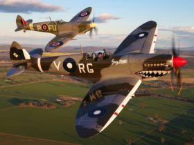 The Temora Aviation Museum's MK VIII Spitfire (front) and MK XVI Spitfire (back) flying in formation