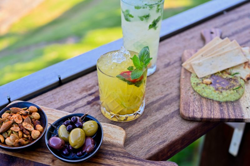Enjoy a selection of our gorgeous house cocktails and snacks in the sun on the Deck