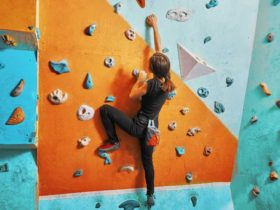 Image of a lady on a climbing wall