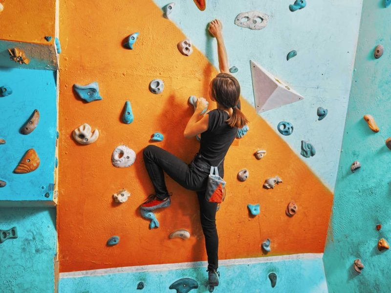 Image of girl rock climbing
