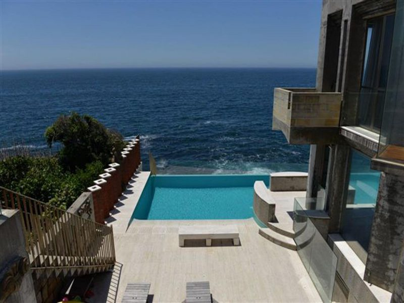 the terrace with aquamarine infinity pool and view