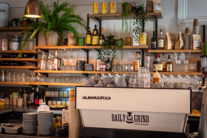 Coffee Machine & Bar Area with shelves, fresh greenery and indoor plants, retail products and drinks