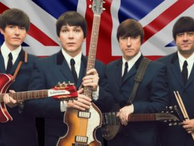four man standing at the back of British flag with guitar