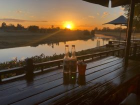 Photo of beers provided by The Orange Tree Cafe overlooking the Hunter River at sunset