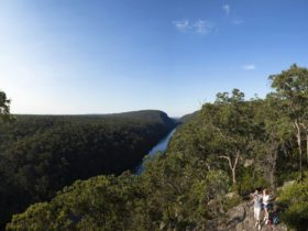 Couple walking near 'The Rock' lookout at Nepean River, Penrith