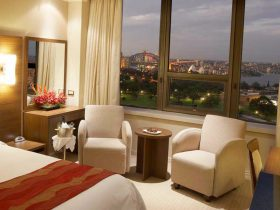 Spoil yourself in rooms overlooking the Sydney Harbour