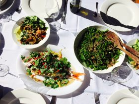 Snapper, prawns and snow pea salad on table