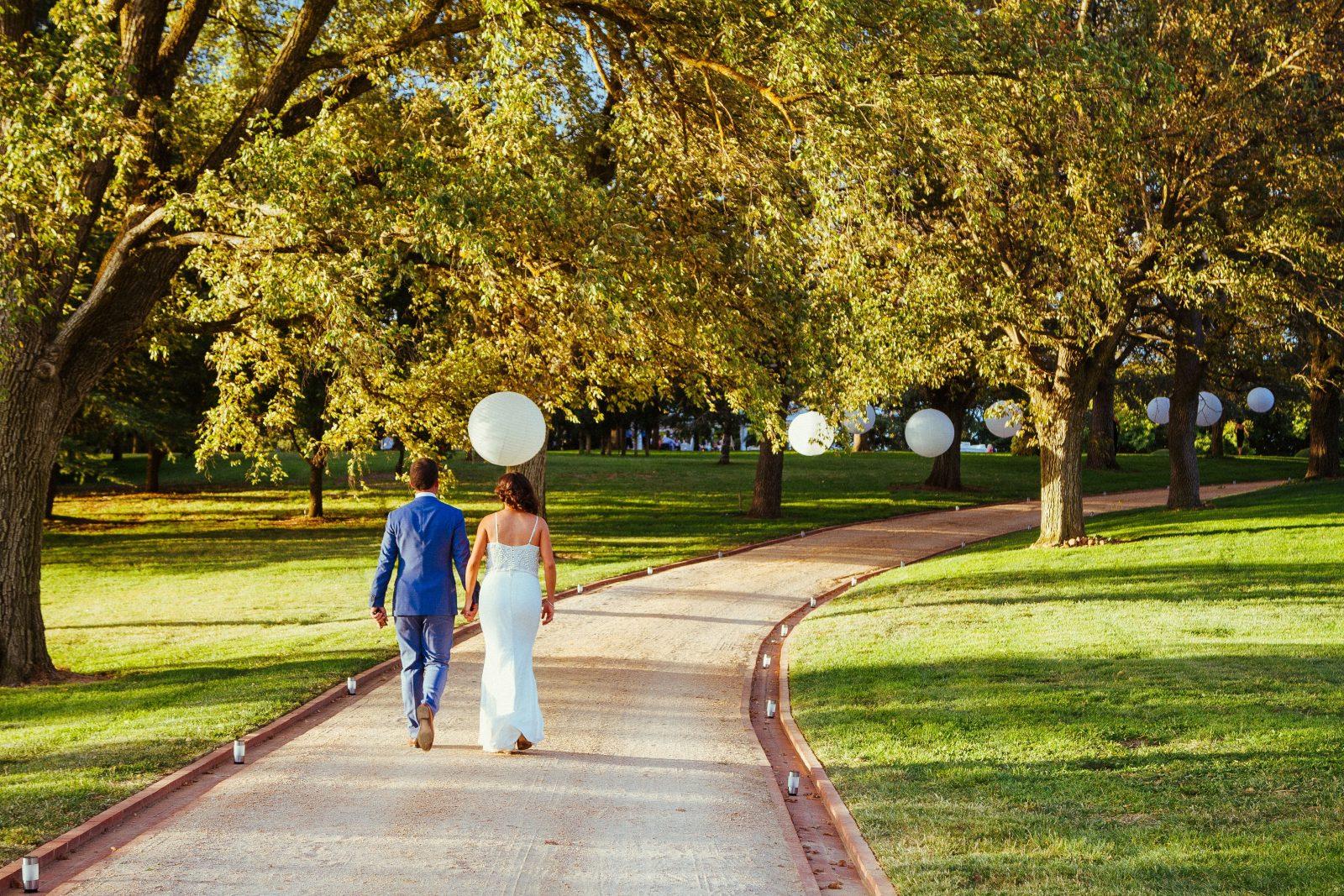 Driveway garden wedding lanterns bride and groom