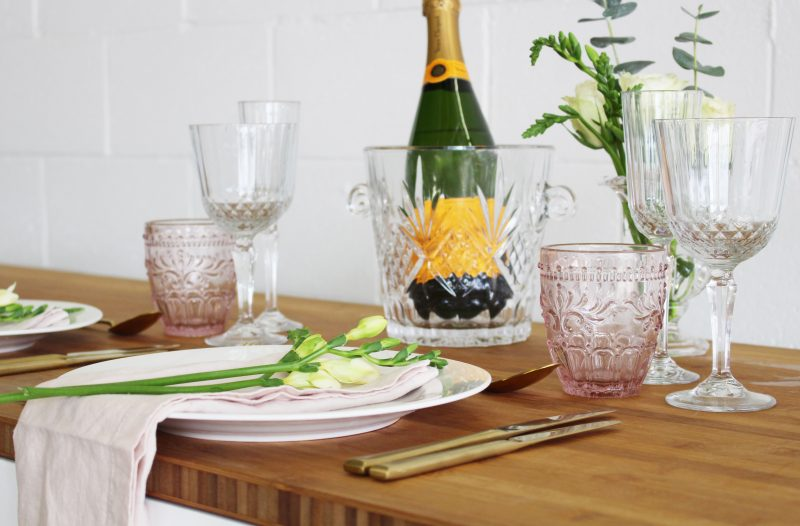 pink crystal cut glasses table setting gold cutlery linen napkins