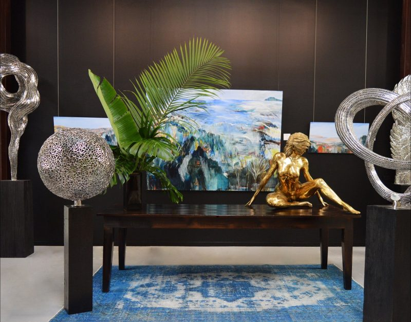Artist Charly Wrencher and sculpture by Christian Maas featured at Thomgallery Byron Bay
