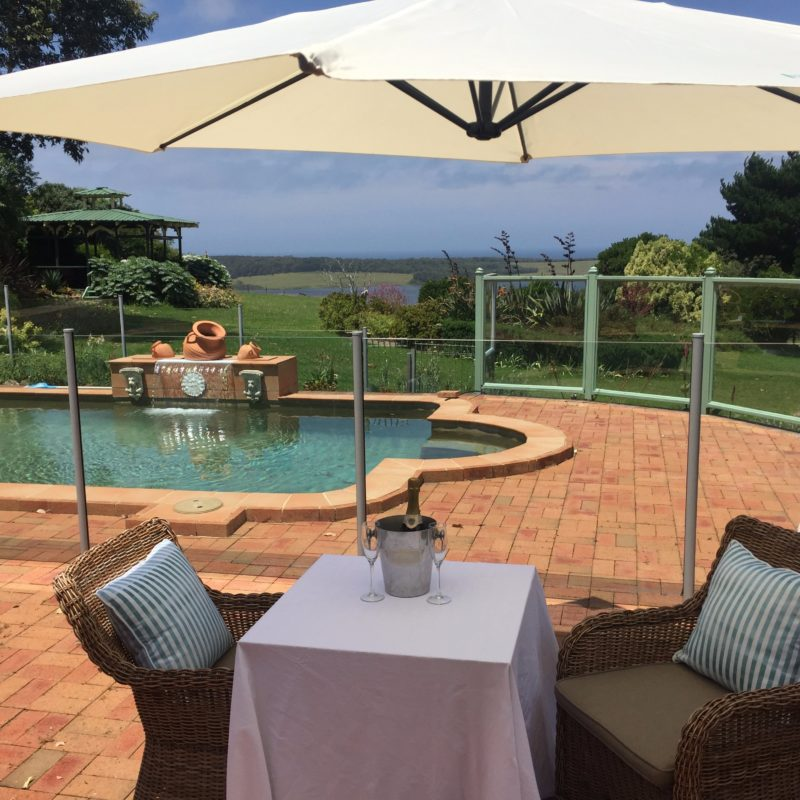 Relax poolside with wine and views