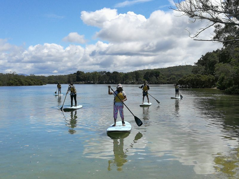 why not try paddle boarding with friends and family?