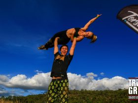 Man lifts woman above head in victorious pose before taking on True Grit NSW