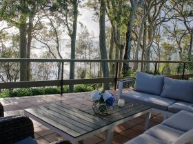 Relax on back veranda overlooking Tuggerah Lake