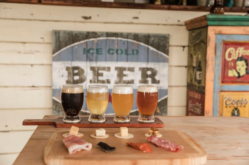 Beer tasting paddle and tasting plate on our Beer Belly Tour