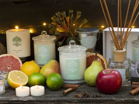 Uaine candles on display with fruit and other decoration