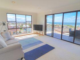Lounge room with pool views