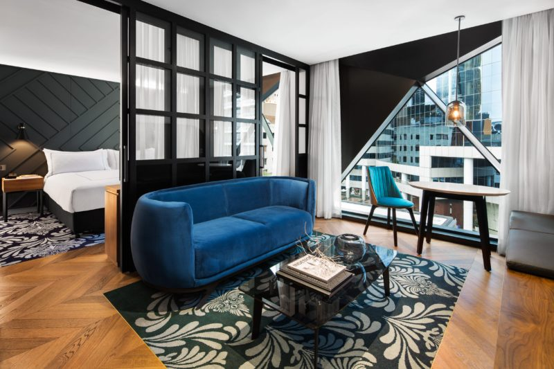 The suite is designed in rejuvenating blues and greens, hardwood parquetry floor and stone bathroom