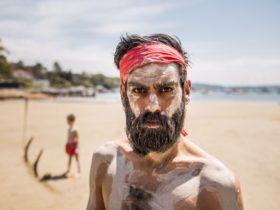Aboriginal performer on Vaucluse Estate Beach