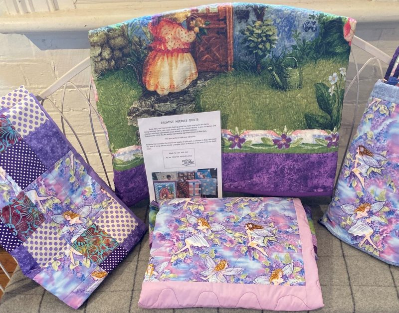 Quilts folded over a bench seat
