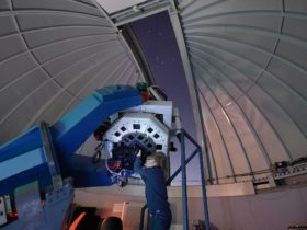Image of a young boy looking thru the telescope