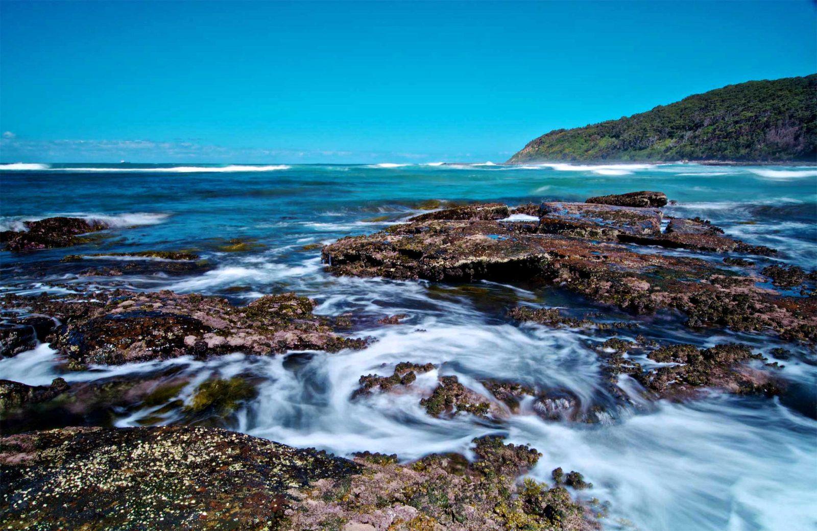 Rocks and water in Bateau Bay, Wyrrabalong National Park. Photo: John Spencer