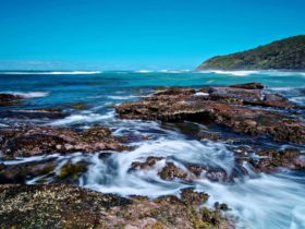 Rocks and water in Bateau Bay, Wyrrabalong National Park. Photo: John Spencer