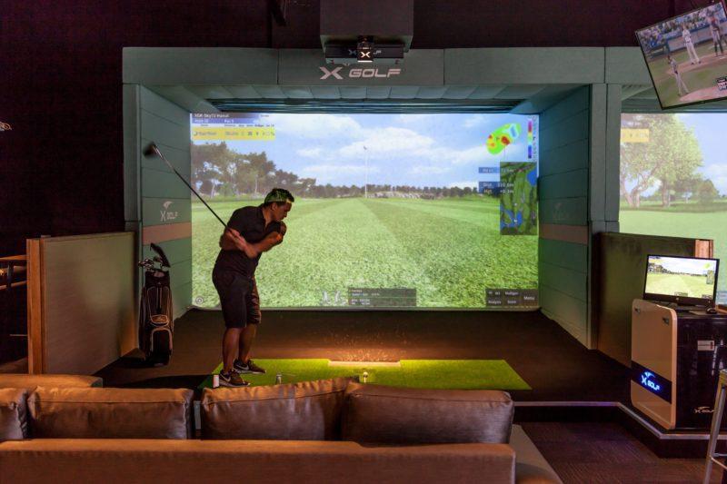 X-Golf Shire | Golfer playing simulator