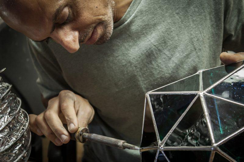 Asaf Zakay working on a glass sculpture