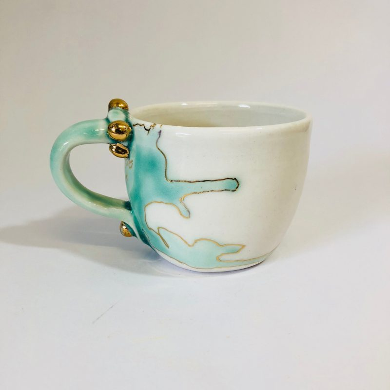 Photo shows a sample of Zeynep's recent porcelain mug from the 'Meander' series