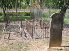 Rudimentary graves at Adelaide River Pioneer Cemetery.