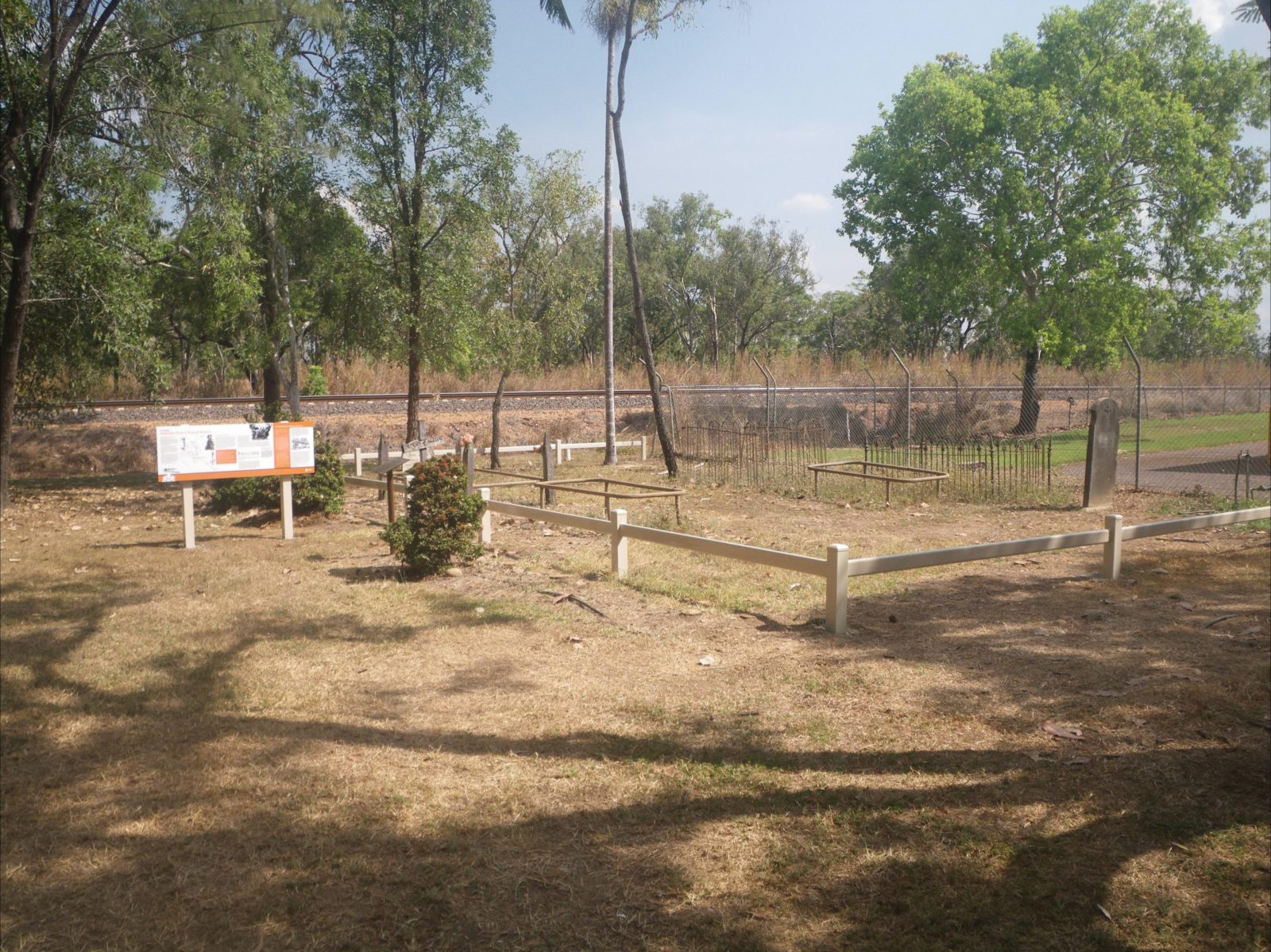 Photograph of the small cemetery with interpretive signage at Adelaide River.