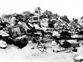 ink felt tip picture of rubbish mound, including disposed tvs and computers, a bike and a crow