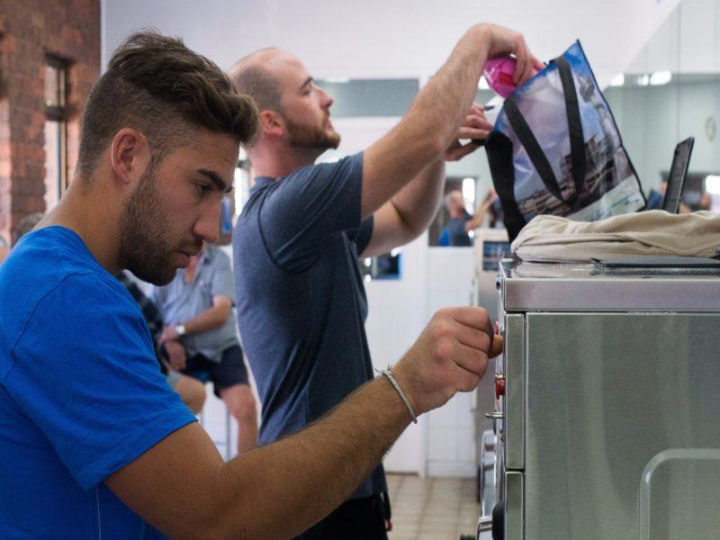 Men doing the washing